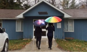 Two women walking into a Nature Centre