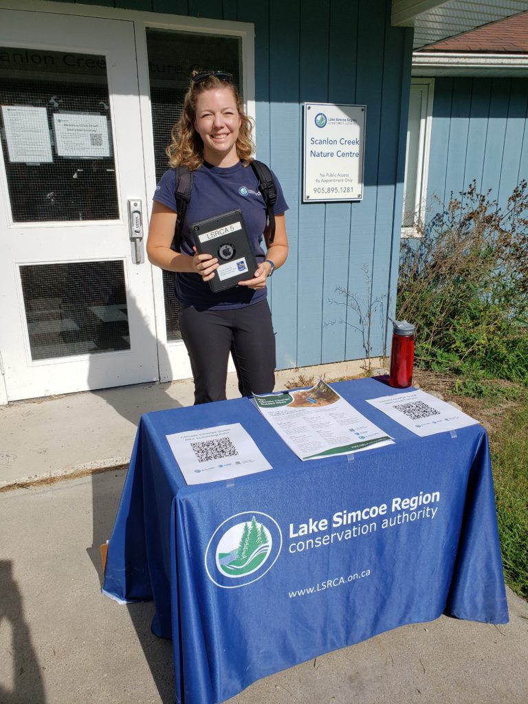 Lake Simcoe Region Conservation Authority staff member standing at registration desk